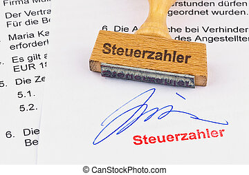 wooden stamp on the document: taxpayer