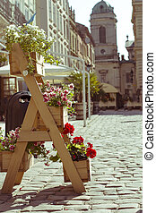 wooden stand for flowers in the city