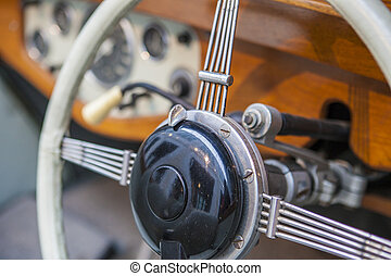 Wooden steering wheel in a classic luxury car