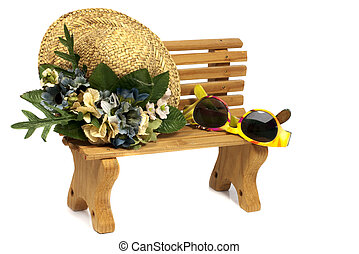 wooden stool with old hat and sunglasses