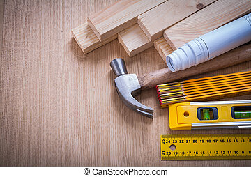 Wooden studs and meter ruler hammer blueprints construction leve