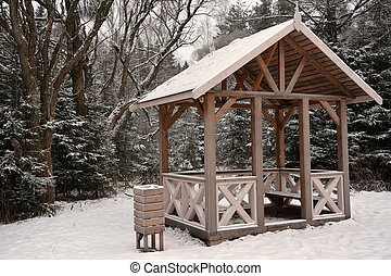 Wooden summerhouse at the winter season. Sepia toned
