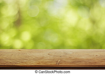 Wooden surface on green background