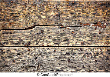 Wooden surface with old metal rivets background