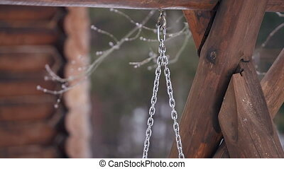 wooden swing in the forest winter