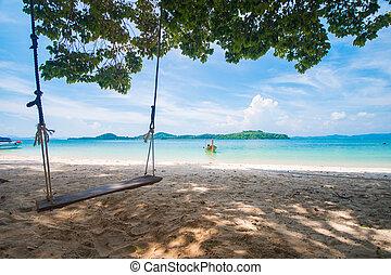 wooden swing on Naka Noi island in Phuket, Thailand