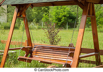 Wooden swing on the playground.