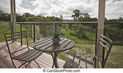 Wooden table and chairs on a deck