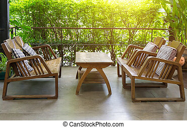 Wooden table and chairs outdoor furniture in the garden for relaxation.