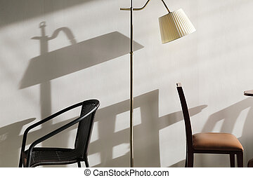 Wooden table and chairs with lamp on wall