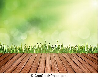 wooden table and grass over abstract blurred background -...
