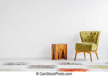 Wooden table by the armchair