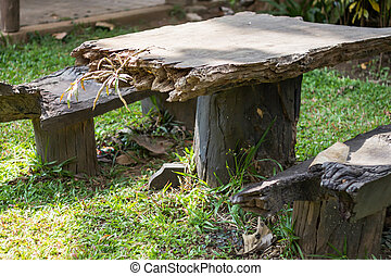 Wooden table decorated in garden