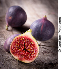 wooden table, figs, fris