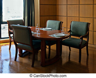 wooden table in a restaurant in the interior in shades of ...