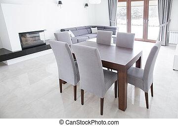 Wooden table in elegant interior