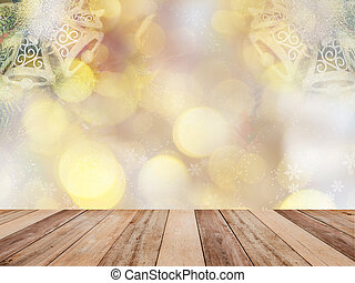 Wooden table top over abstract Christmas background with ornament decoration and golden bokeh.