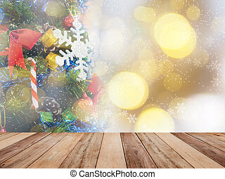 Wooden table top over abstract Christmas ornament decoration on pine tree