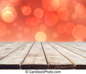 Wooden table with a nice red boked background