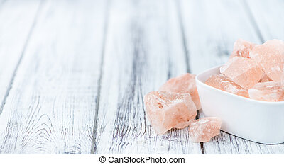Wooden table with a portion of pink Salt