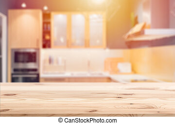 Wooden table with blur kitchen background