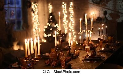 wooden table with burning candles