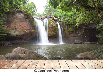 Wooden table with environmental in water fall forest.