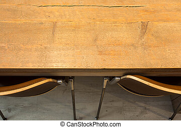 Wooden table with modern chairs top view. interior design background texture
