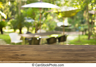 wooden table with space for your photo montage and green...