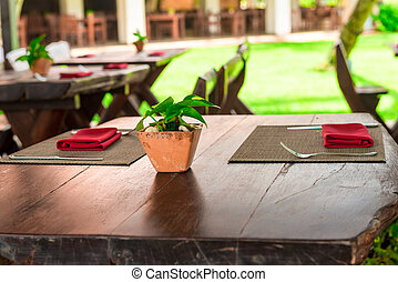 Wooden tables of a summer cafe in the open air