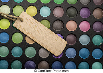 Wooden tag and makeup palettes