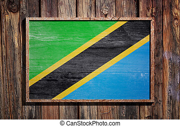 3d rendering of Tanzania flag on a wooden frame over a planks wall