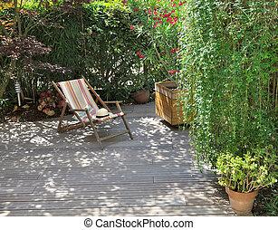 wooden terrace and deckchair - deckchair on wooden terrace