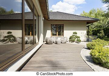 Wooden terrace by suburban villa