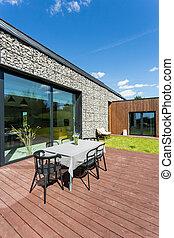 Wooden terrace with garden furniture