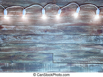 wooden textured background with light garland