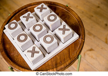 Wooden tic tac toe OX game. The concept of strategy, risk, competition in business. vintage letterpress printing block X and O in wooden grunge typesetter box. cross-zero. Gambling for money