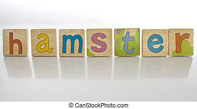 wooden tiles - spelling HAMSTER