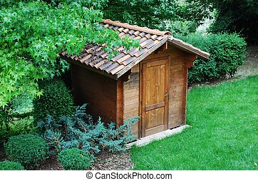 Wooden tool shed - Wooden garden tool shed in a beautiful ...