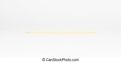 wooden toothpick on a white background