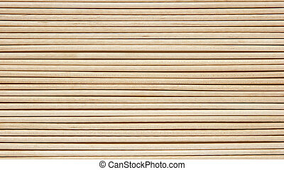 Wooden toothpicks are laid out in a number of