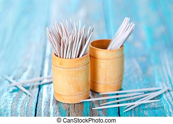 toothpicks - wooden toothpicks on the green table, toothpick...