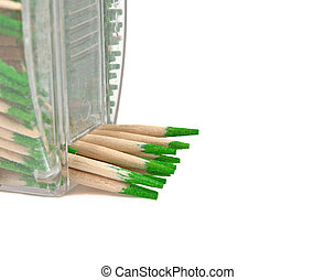 wooden toothpicks stick out of the packaging on a white background