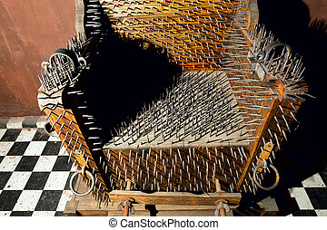 torture chair - wooden torture chair with iron spikes