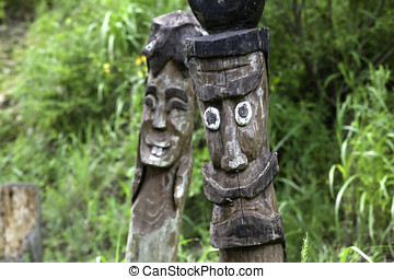Wooden totem poles.