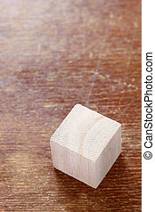 wooden toy block on wooden table