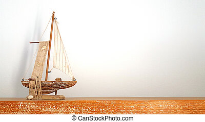 wooden toy boat ship on wood board