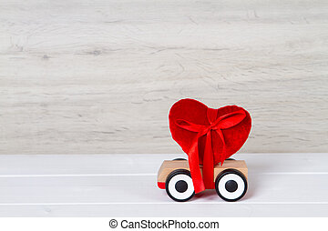 wooden toy car with red heart