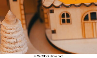 Wooden toy house in which wooden Christmas locomotive rides....