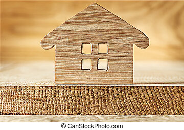 wooden toy house on wood background